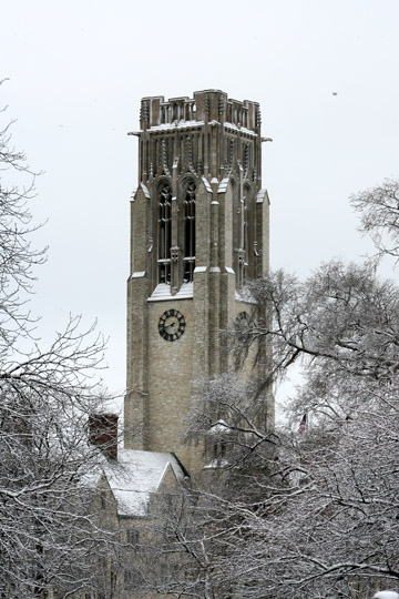 Snowy winter pictures of main campus University Hall clock tower