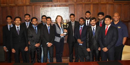 The UT Cricket Club showed off its second-place trophy from the 2016 American College Cricket Midwest Championship. Posing for the photo were, from left, Koushik Rajapandian, Mahesh Pillai, Raj Patel, Akshay Chawan, Govind Sharma, Balram Yadav, President Sharon L. Gaber, Mohammad Wadood Majid, Rajeev Reddy, Naveen Tripathi, Swapnil Jadhav, Raviraj Wala, Abhijeet Thakur, and Dr. Sammy Spann, assistant provost for international studies and programs.