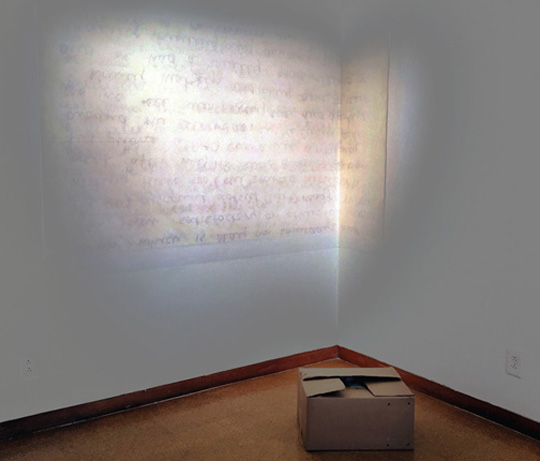 "An installation titled ""Threads"" by Deborah Orloff features a color photograph on vinyl and a carton of old letters, photographs and slides."