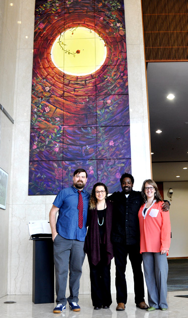 Standing in front of the mural painted by incarcerated participants was revealed were, from left, Matt Taylor, Emily Numbers, Yusuf Lateef and Rachel Richardson. The four, who worked together to make the project happen, spoke at a press conference when the work was revealed.