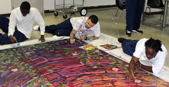 Incarcerated individuals worked on the mural at the Toledo Correctional Institution.
