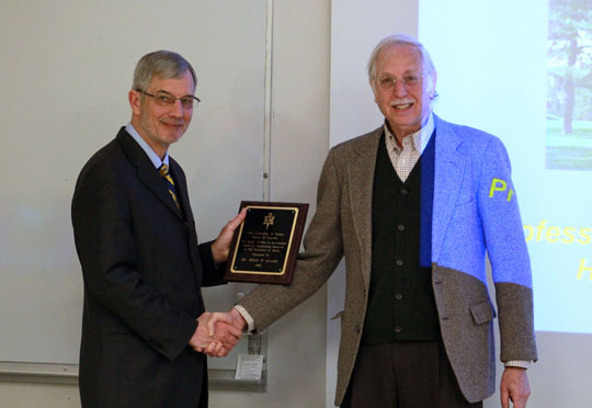 Dr. Steven Federman, right, shook hands with Dr. Blair Grubb after presenting him with the 2015-2016 Dion D. Raftopoulos/Sigma Xi Award for Outstanding Research.