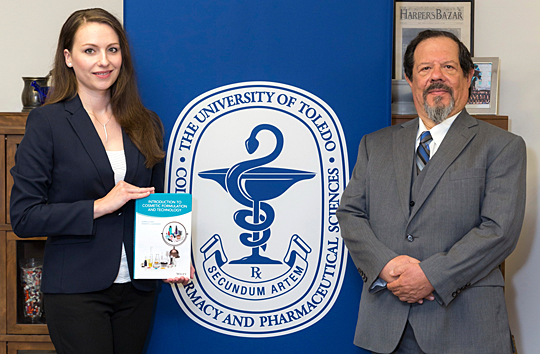 Dr. Gabriella Baki and Dr. Kenneth Alexander of the Department of Pharmacy Practice posed for a photo with their new textbook, Introduction to Cosmetic Formulation and Technology, which they wrote for UT's Cosmetic Science and Formulation Design Program.