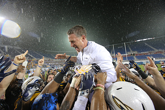 Toledo players lifted up Head Coach Jason Candle after the Rockets poured it on to beat the then-No. 24 Temple Owls, 32-17, Dec. 22 in the Marmot Boca Raton Bowl in Florida Atlantic University Stadium.