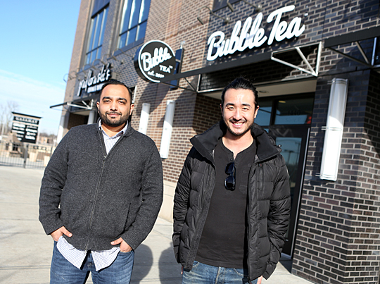 UT graduates Prakash Karamchandani, left, and Hochan Jang posed for a photo outside of their latest establishment, Bubble Tea, which is located in the Gateway.