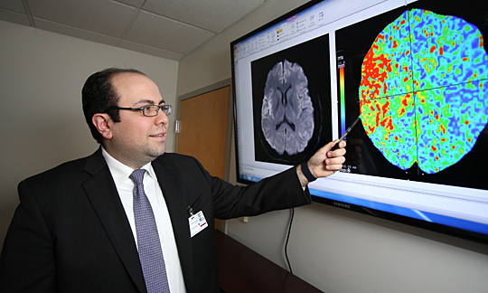 Dr. Mouhammad Jumaa, assistant professor and director of the Stroke Center and co-director of the Stroke Network, studied the brain scan of a stroke patient.
