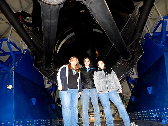 UT students Jessica Moore, left, Anthony Howarth, center, and Megan Banks posed for a photo last fall with Lowell Observatory's Discovery Channel Telescope in Arizona.
