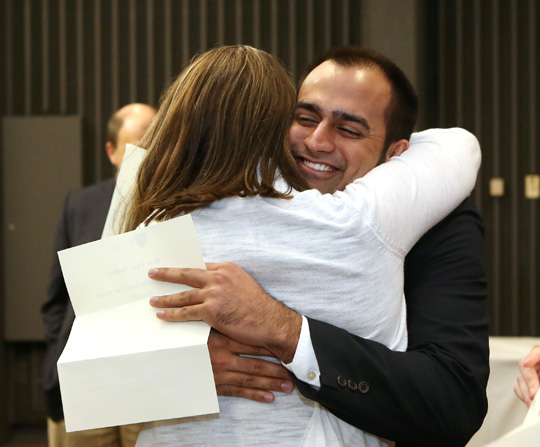 Erin Main and Vijay Mehta hugged during the Match Day ceremony. Main matched in internal medicine at the University of Minnesota Medical School, and Mehta is headed to Jackson Memorial Hospital in Miami, Fla., for internal medicine.