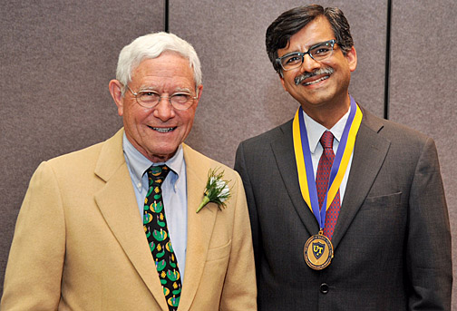 Dr. Kenneth A. Kropp presented a medallion to Dr. Puneet Sindhwani, who was awarded the first Kenneth A. Kropp, MD, Endowed Professorship in Urology.