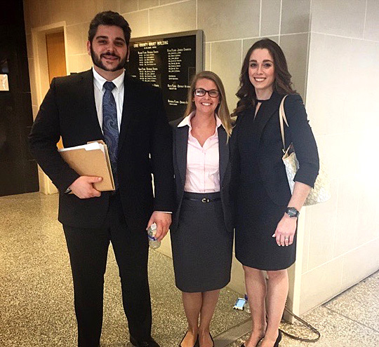 UT law students Thomas Walsh and Lindsey Cavese, center, posed for a photo with their coach, UT law student Katrin McBroom, at the Herbert Wechsler National Criminal Moot Court Competition.