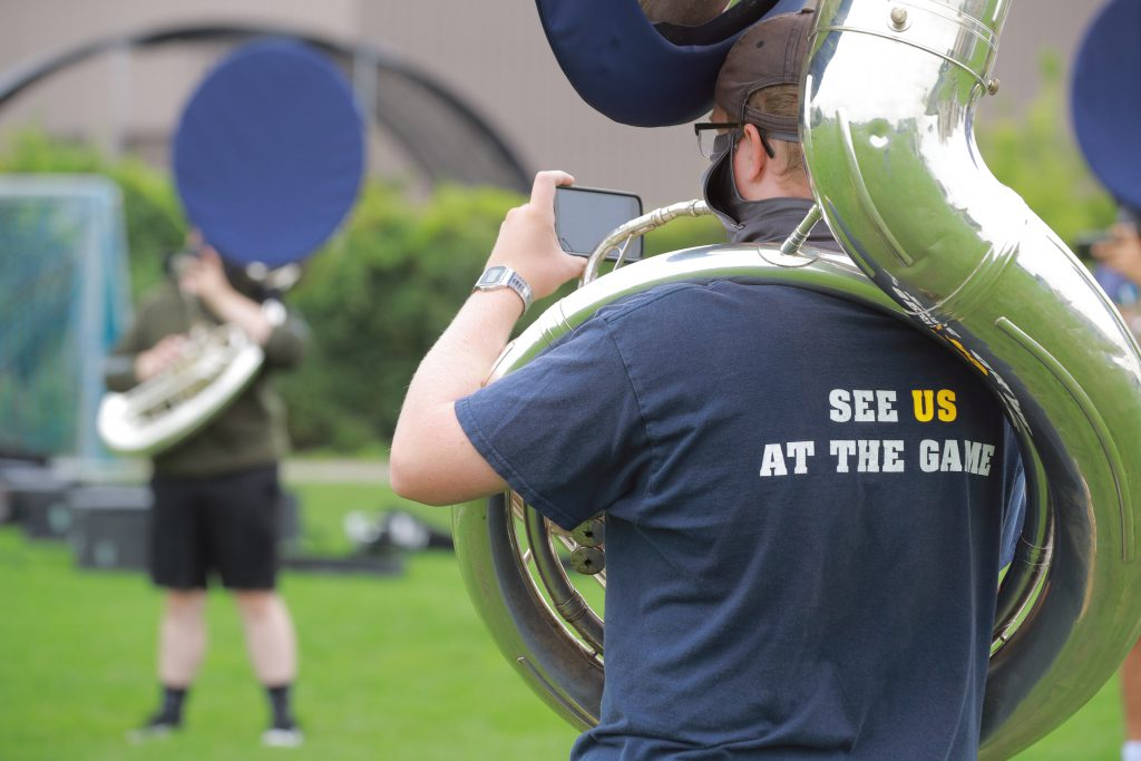 A member of the marching band plays the sousaphone during rehearsal