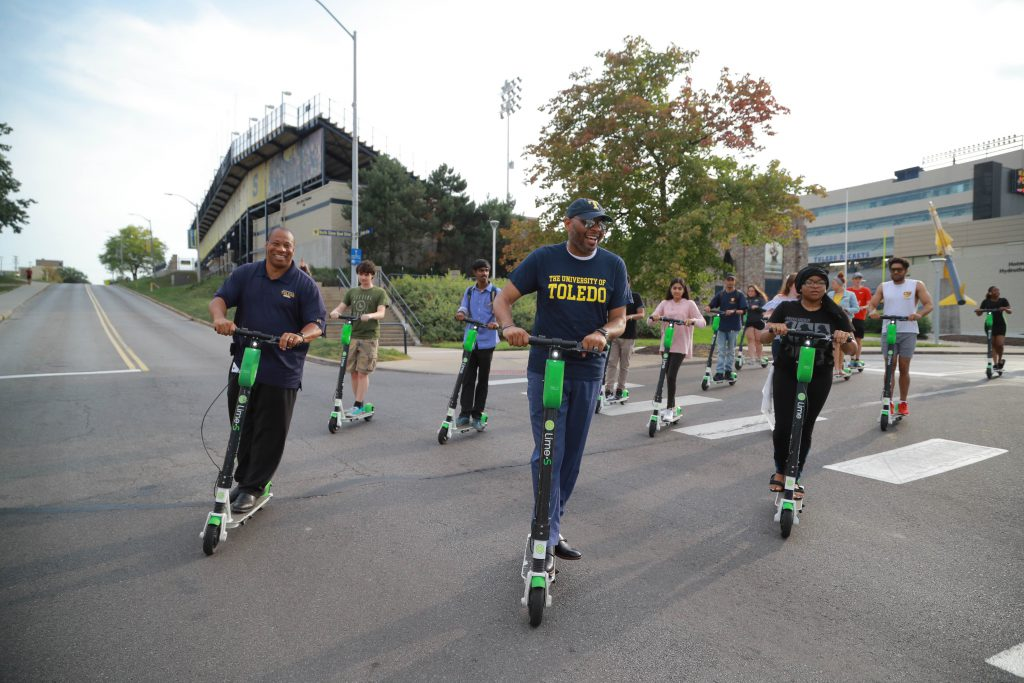 Dr. Flapp Cockrell leads a campus tour on Lime scooters by the Glass Bowl