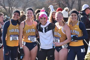 Posing for photo with teammates after Cross Country Championship Meet