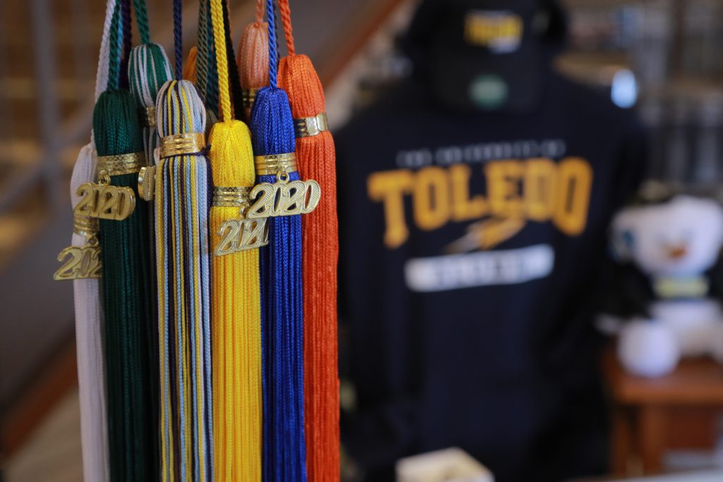 Graduation tassels on display near alumni sweatshirt and other merchandise at UToledo Bookstore