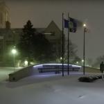Snowfall on campus near Field House