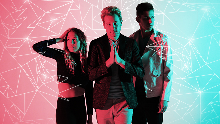 Logan Aexander, center, with Allison on his right and Eric on his right in front of pink and teal background