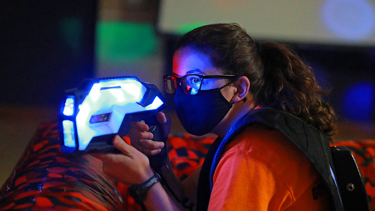 Julia Hatfield, a biomedical engineering sophomore, plays laser tag in the Student Union Auditorium during one of the activities Monday to kick off Student Appreciation Week.