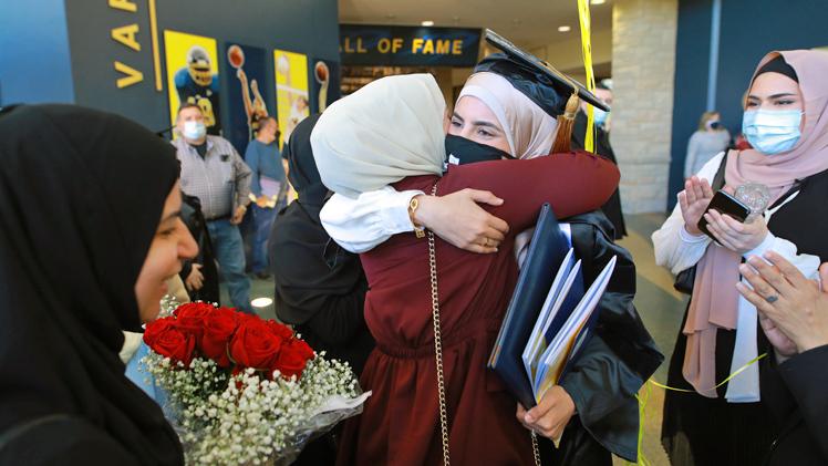Wijdan Alyasiry hugs family after graduation